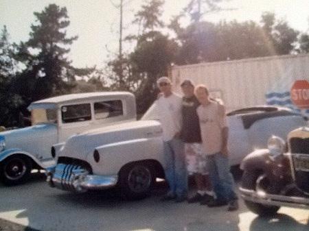 Denis Velarde & friends working on old cars.