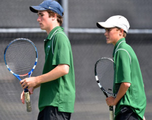 Tom's and Laura's sons Sam (17) and Hank (15) playing #1 doubles together on their high school tennis team